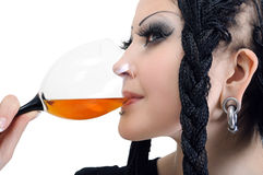 Young stylish woman with dreadlocks, drinking wine. Isolated on white stock photo