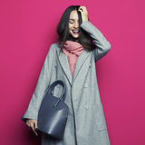 Young stylish woman in grey coat Royalty Free Stock Image