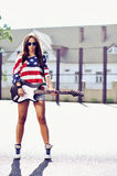 Young stylish woman with guitar outdoor fashion portrait.  Royalty Free Stock Image