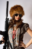 Young stylish woman with a gun Royalty Free Stock Photo