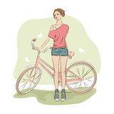 Young stylish woman and her bike. Royalty Free Stock Photography