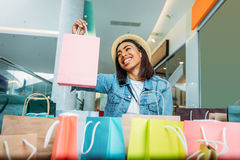 Young stylish woman holding shopping bag, boutique shopping concept Royalty Free Stock Photography