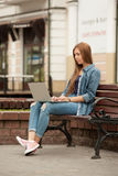 Young stylish woman with a laptop. Royalty Free Stock Photography
