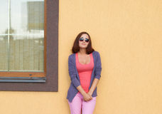 Young stylish woman posing against the wall. Royalty Free Stock Photography