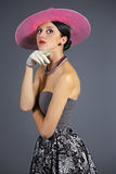 Young stylish woman with purple retro hat Royalty Free Stock Images