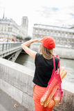 Woman walking with french food in Paris Royalty Free Stock Photo