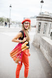 Woman walking with french food in Paris Stock Photos