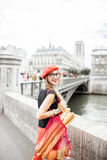 Woman walking with french food in Paris stock image