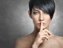 Young stylish woman, showing silence gesture Royalty Free Stock Images
