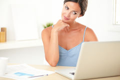 Young stylish woman sitting while studying Royalty Free Stock Images