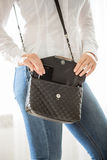 Young stylish woman taking cellphone out of handbag Stock Photography