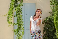 Young stylish woman talking on phone in the Greek Stock Images