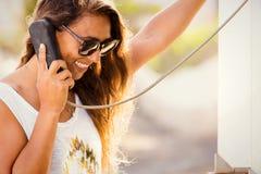 Young stylish woman at telephone box. phone talk retro style. Royalty Free Stock Photo