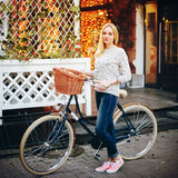 Young stylish woman on a vintage bicycle Stock Images