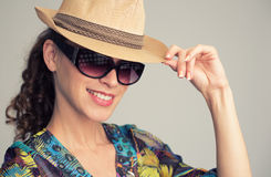 Young stylish woman wearing hat and sunglasses Royalty Free Stock Images