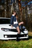 Young stylish woman and white power car Royalty Free Stock Photo