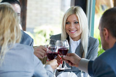 Young succesful businesspeople toasting Stock Images