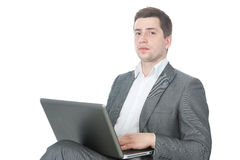 Young success businessman with laptop Royalty Free Stock Photos