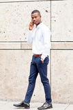 Young successfil african businessman with mobilephone. Talking walking outdoor Royalty Free Stock Photos
