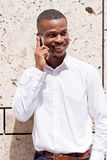 Young successfil african businessman with mobilephone Stock Photos