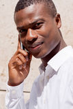 Young successfil african businessman with mobilephone Royalty Free Stock Photos