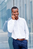 Young successful african businessman with mobilephone Stock Photo