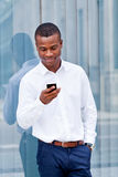 Young successful african businessman with mobilephone Royalty Free Stock Image