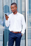 Young successful african businessman with mobilephone Stock Photos
