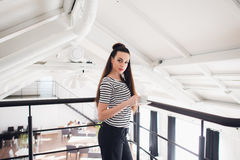 Young and successful. Attractive young woman in smart casual wear holding coffee cup and looking at camera while Royalty Free Stock Photos