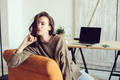 Young successful blogger or businesswoman working at home online with laptop and cup of coffee in the morning Stock Images
