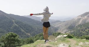 Young successful boxer on top of mountain stock footage