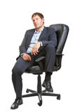 Young successful business man in executive chair Royalty Free Stock Images