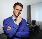 Young successful business man at office. Royalty Free Stock Photos