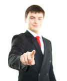 Young successful business man pressing imaginary button Stock Photography