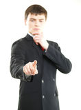 Young successful business man pressing imaginary button Stock Images