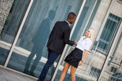 Young successful business man and woman outdoor Stock Photos