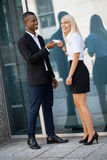 Young successful business man and woman outdoor Stock Photography