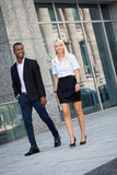 Young successful business man and woman outdoor Stock Images