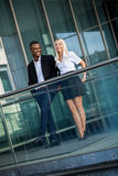 Young successful business man and woman outdoor Stock Image
