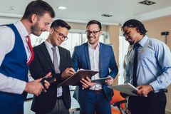 Successful business team in office. Selective focus. Young and successful business team in office. Selective focus stock photos