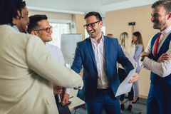 Successful business team in office. Selective focus. Young and successful business team in office. Selective focus royalty free stock image