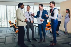Successful business team in office. Selective focus. Young and successful business team in office. Selective focus stock photo