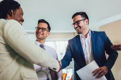 Successful business team in office. Selective focus. Young and successful business team in office. Selective focus royalty free stock photography