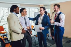 Successful business team in office. Selective focus. Young and successful business team in office. Selective focus royalty free stock images