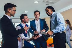 Successful business team in office. Selective focus. Young and successful business team in office. Selective focus stock photography