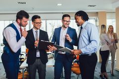 Successful business team in office. Selective focus. Young and successful business team in office. Selective focus royalty free stock photos