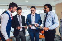 Successful business team in office. Selective focus. Young and successful business team in office. Selective focus royalty free stock photo