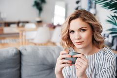 Young successful business woman relaxing at home on cozy couch Stock Image