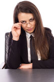 Young successful business woman sitting at her desk Stock Images