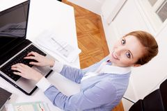 Young successful business woman in office Stock Photography